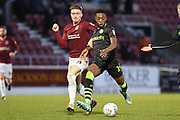 Forest Green Rovers midfielder Ebou Adams (14) shapes to shoot under pressure from Northampton Town midfielder Ryan Watson (8) during the EFL Sky Bet League 2 match between Northampton Town and Forest Green Rovers at the PTS Academy Stadium, Northampton, England on 14 December 2019.