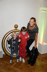 Left to right, LEON HENREKSON-WATSON, LUCAS HENREKSON-WATSON and their mother LISA HENREKSON at a children's tea party to celebrate the 80th anniversary of iCandy - the luxury British pushchair brand held at One Marylebone, Marylebone Road, London NW1 on 10th September 2013.