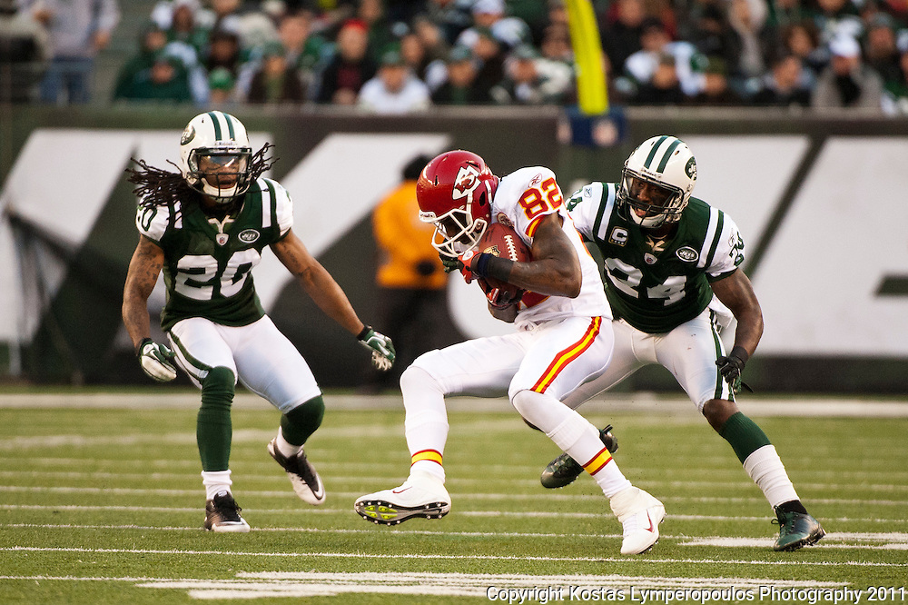 Dec 11, 2011; East Rutherford, NJ, USA; Kansas City Chiefs wide receiver Dwayne Bowe (82) being pursued by New York Jets cornerback Kyle Wilson (20) and New York Jets cornerback Darelle Revis (24)  during the second half at MetLife Stadium.