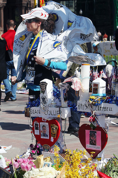 (Boston, MA - 4/29/13) Boston Marathon runner Cami Breen of Hull pauses at the Marathon Memorial after running the last leg of the marathon route, since she was stopped at Boylston Street and was unable to complete the marathon due to the bombing, Monday, April 29, 2013. Staff photo by Angela Rowlings.