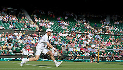 LONDON, ENGLAND - Wednesday, June 29, 2011: Andy Murray (GBR) plays in front of a half-empty centre court at the start of the Gentlemen's Singles Quarter-Final match on day nine of the Wimbledon Lawn Tennis Championships at the All England Lawn Tennis and Croquet Club. (Pic by David Rawcliffe/Propaganda)