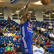 Westchester Knicks Forward Orlando Sanchez (21) dunks the ball as Delaware 87ers Forward Ronald Roberts (12) defends in the first half of a NBA D-league regular season basketball game between the Delaware 87ers and the Westchester Knicks (New York Knicks) Sunday, Dec. 28, 2014 at The Bob Carpenter Sports Convocation Center in Newark, DEL