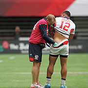 The Canada 7's has something for everybody, even a personal muli massage for USA Eagle Martin Iosefo when needed in the Eagles 17-12 win over England at the Canada 7's Vancouver, British Columbia, Day 1.   Photo by Barry Markowitz, 4/12/16, 10:30 am