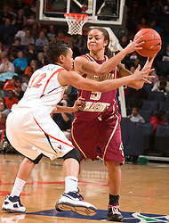 Boston Coll. guard Victoria Jones (5) is guarded by Virginia guard Britnee Millner (12).  The #21 ranked Virginia Cavaliers defeated the Boston College Eagles 90-70 at the John Paul Jones Arena in Charlottesville, VA on February 22, 2009.