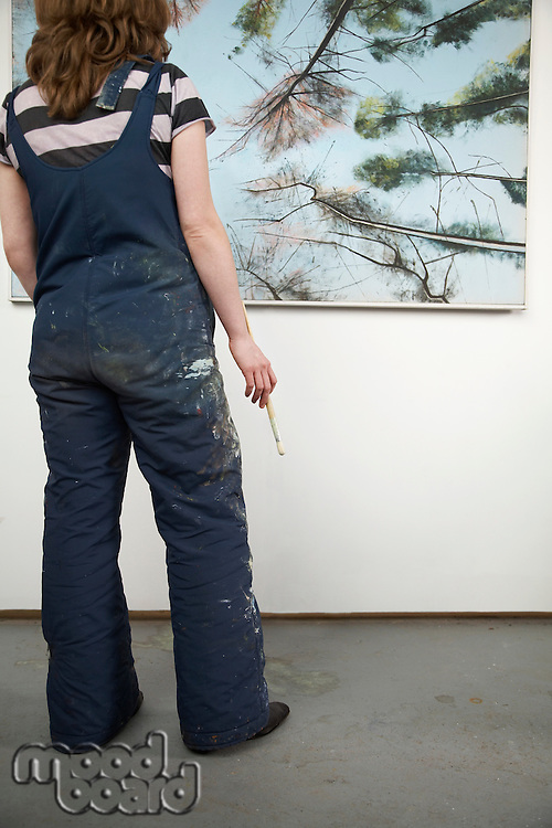 Artist looking at painting back view