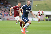 Southend United defender John White (2) looks to release the ball during the EFL Sky Bet League 1 match between Northampton Town and Southend United at Sixfields Stadium, Northampton, England on 24 September 2016. Photo by Dennis Goodwin.