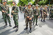 23 MAY 2014 - BANGKOK, THAILAND:  Thai soldiers on duty at a checkpoint in Bangkok. The Thai military seized power in a coup Thursday evening. They suspended the constitution and ended civilian rule. This is the 2nd coup in Thailand since 2006 and at least the 12th since 1932.   PHOTO BY JACK KURTZ