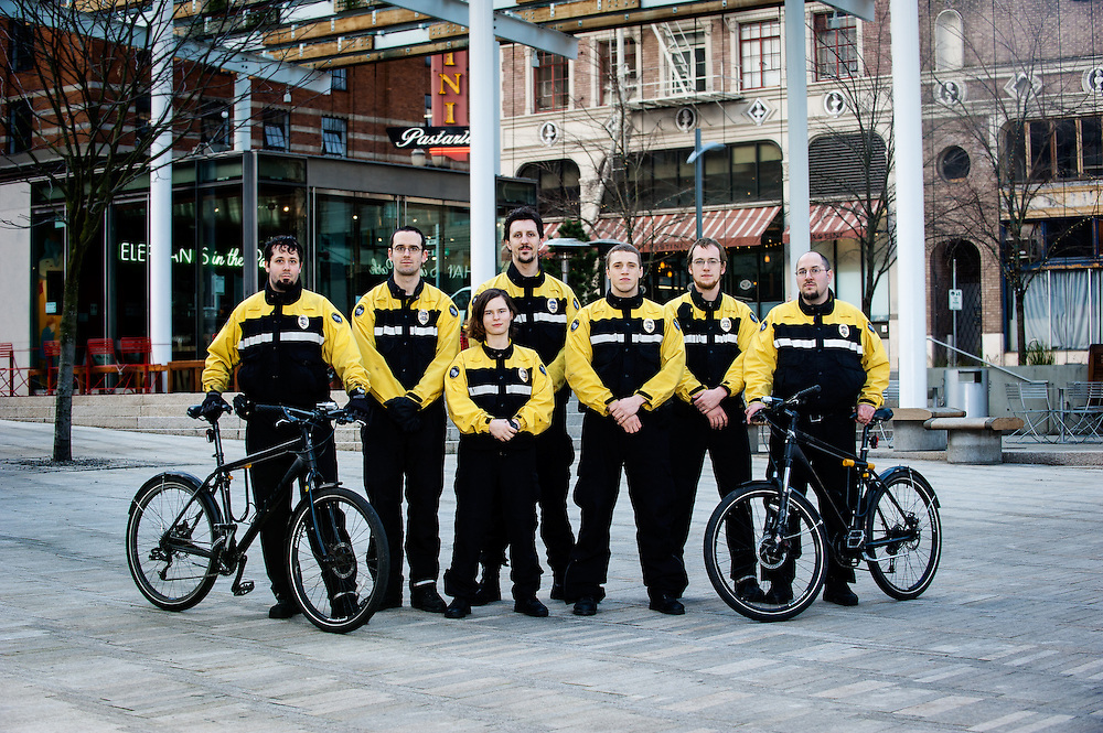 Pacific Patrol Services bicycle security patrol staff group portrait in Director's Park, Portland, Oregon.