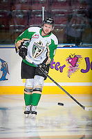 KELOWNA, CANADA - DECEMBER 6: Josh Morrissey #10 of Prince Albert Raiders passes the puck during warm up against the Kelowna Rockets on December 6, 2014 at Prospera Place in Kelowna, British Columbia, Canada.  (Photo by Marissa Baecker/Shoot the Breeze)  *** Local Caption *** Josh Morrissey;