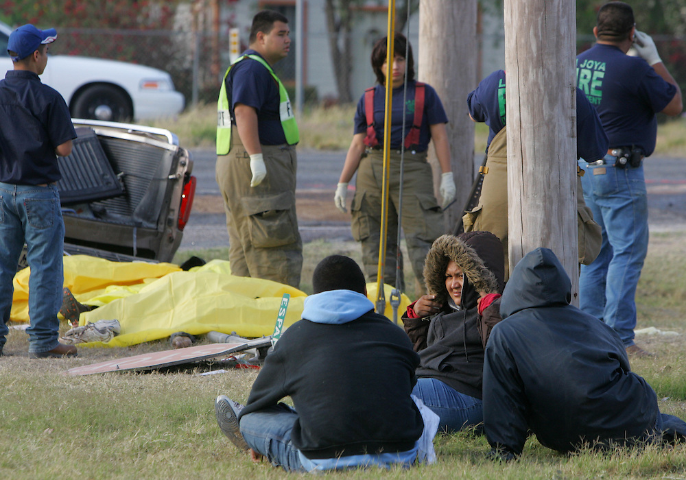 Penitas, TX - 27 Mar 2008 -.Illegal immigrants wait to be transported by US Border Patrol officers at the scene of a triple fatality car accident on US 83 at Española st. in Penitas on Thursday morning.  .Photo by Alex Jones / ajones@themonitor.com
