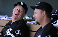 TEMPE, AZ - MARCH 4:  Third base coach Jeff Cox #6 laughs while talking to A.J. Pierznski #12 of the Chicago White Sox during a spring training game against the Los Angeles Angels on March 4, 2010 at Tempe Diablo Stadium in Tempe, Arizona. (Photo by Ron Vesely)