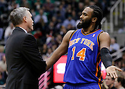 New York Knicks center Ronny Turiaf, right, has words with Knicks head coach Mike D'Antoni, left after being taken out during the first half of an NBA basketball game against the Utah Jazz in Salt Lake City, Wednesday Jan. 12, 2011. (AP Photo/Colin E Braley)