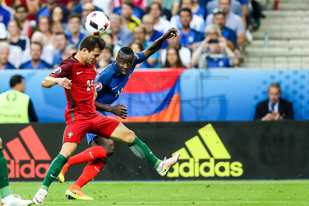 Cédric Soares from Portugal fighting for the ball with a french player during the match against France. Portugal won the Euro Cup beating in the final home team France at Saint Denis stadium in Paris, after winning on extra-time by 1-0.
