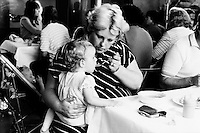 Women feeding child at a soup kitchen run by miners wives and members of womens support groups for striking miners families during the 1984-85 strike. Cortonwood Miners Welfare...&copy; Martin Jenkinson <br /> email martin@pressphotos.co.uk  NUJ recommended terms &amp; conditions apply. Copyright Designs &amp; Patents Act 1988. Moral rights asserted credit required. No part of this photo to be stored, reproduced, manipulated or transmitted by any means without prior written permission.