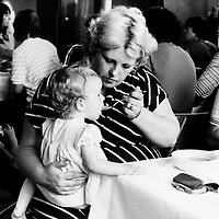 Women feeding child at a soup kitchen run by miners wives and members of womens support groups for striking miners families during the 1984-85 strike. Cortonwood Miners Welfare.