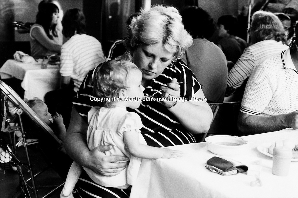 Women feeding child at a soup kitchen run by miners wives and members of womens support groups for striking miners families during the 1984-85 strike. Cortonwood Miners Welfare...&copy; Martin Jenkinson <br />