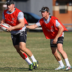 DURBAN, SOUTH AFRICA - AUGUST 13 - Jean Deysel  with Joe Pietersen during the Cell C Sharks training session at Growthpoint Kings Par in Durban, South Africa. (Photo by Steve Haag)