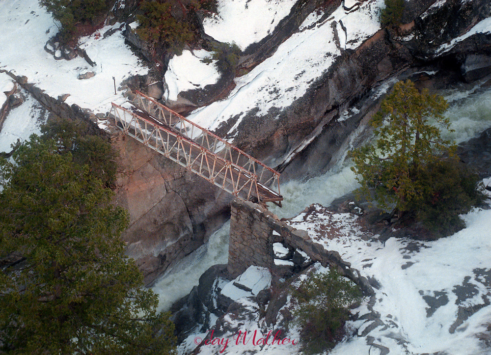 In the back country of Yosemite National Park many bridges were damaged or simply washed away during the January 2, 1997 flooding in the Park's rivers.  The flooding on the Merced River nearly destroyed this bridge on the Muir Trail between Vernal and Nevada Falls.  January 1997