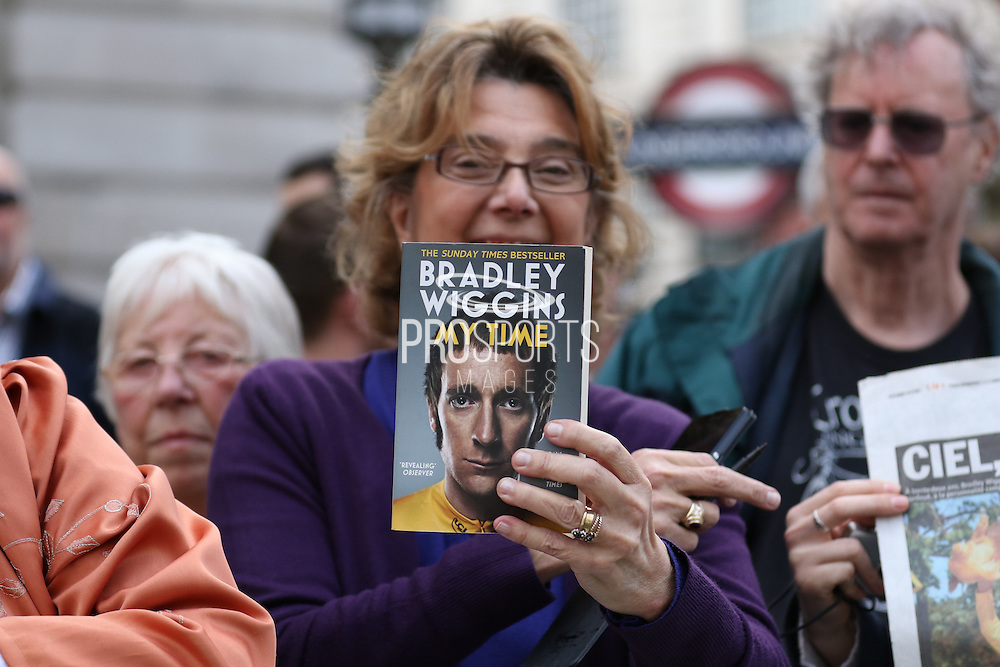 Fan with a copy of Sir Bradley Wiggins book My Time during the London Stage of the Aviva Tour of Britain, Regent Street, London, United Kingdom on 13 September 2015. Photo by Ellie Hoad.