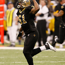 Oct 31, 2010; New Orleans, LA, USA; New Orleans Saints linebacker Jonathan Vilma (51) celebrates following a Pittsburgh Steelers turnover late in the fourth quarter at the Louisiana Superdome. The Saints defeated the Steelers 20-10.  Mandatory Credit: Derick E. Hingle..