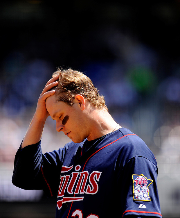 NEW YORK - MAY 15: Justin Morneau #33 of the Minnesota Twins rubs head against the New York Yankees at Yankee Stadium on May 15, 2010 in the Bronx borough of Manhattan. The Yankees defeated the wins 7 to 1. (Photo by Rob Tringali) *** Local Caption ***  Justin Morneau