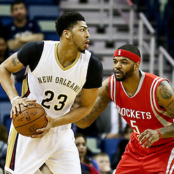 Jan 25, 2016; New Orleans, LA, USA; New Orleans Pelicans forward Anthony Davis (23) is defended by Houston Rockets center Josh Smith (5) during the first quarter of a game at the Smoothie King Center. Mandatory Credit: Derick E. Hingle-USA TODAY Sports
