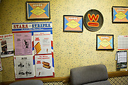 The Wienerschnitzel office is decorated with awards and signage during its 17 years of service in Milpitas, California, photographed on February 22, 2014.  The S. Park Victoria Dr. location is closing its doors after 17 years of service after the the stores lease was not renewed. (Stan Olszewski/SOSKIphoto)