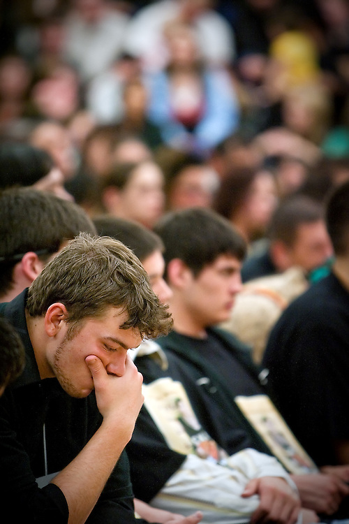 JEROME A. POLLOS/Press..Arthur Elwell listens to the memorial service for his friend and teammate Tim Wolfe.