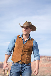 good looking rugged cowboy outdoors on a ranch