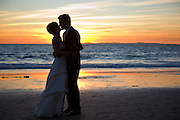 Married Orange County Couple Kissing At Sunset In Laguna Beach