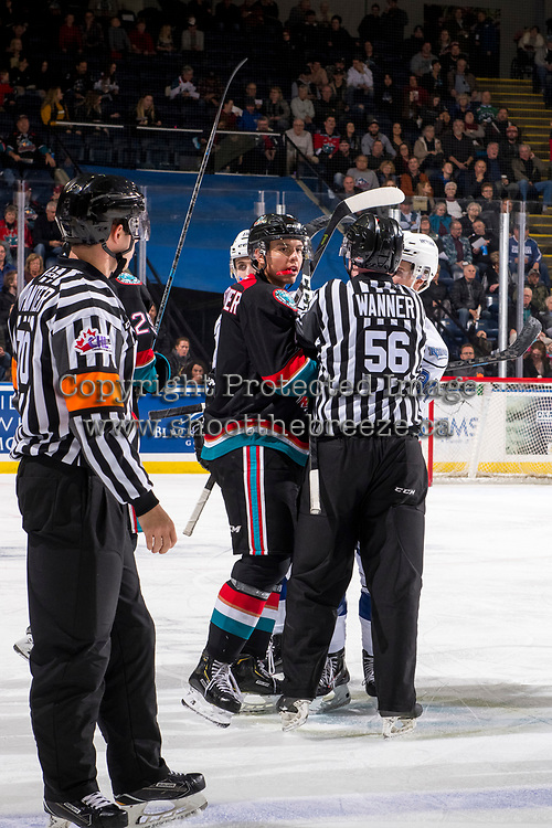 KELOWNA, CANADA - NOVEMBER 23:  Linesman Cody Wanner gets between Devin Steffler #4 of the Kelowna Rockets and Kaid Oliver #34 of the Victoria Royals on November 23, 2018 at Prospera Place in Kelowna, British Columbia, Canada.  (Photo by Marissa Baecker/Shoot the Breeze)