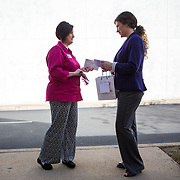 Shelby, NC - February 1, 2017: AVON representative, Rehnea Walton, makes a delivery to her customer, Laura Hopper, outside of her workplace in downtown Shelby, NC.  Because of the rapport Rehnea developes with her customers, she is willing to be flexible with their schedules and meets where it's most convenient for them.  (CREDIT: Logan R. Cyrus for The Wall Street Journal)   AVON