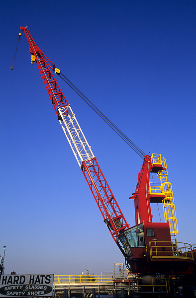 Stock photo of the view of a crane and hard hat work area