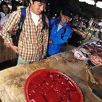 Tourists debate curdled blood, Luang Phrabang