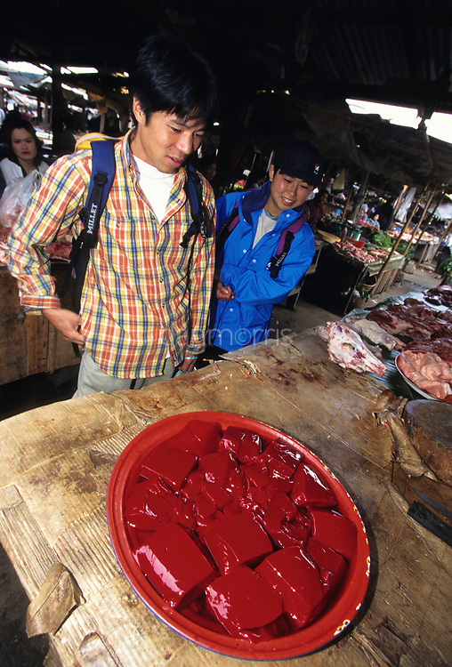 Tourists debate curdled blood, Luang Phrabang