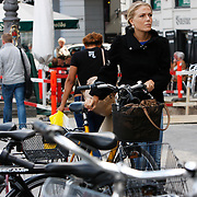 Cycling in Copenhagen is – as with most cycling in Denmark – an important means of transportation and a dominating feature of the cityscape, often noticed by visitors.<br /> Photography by Jose More
