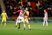Ed Upson of Bristol Rovers challenges Kieran Sadlier of Doncaster Rovers during the EFL Sky Bet League 1 match between Doncaster Rovers and Bristol Rovers at the Keepmoat Stadium, Doncaster, England on 26 March 2019.