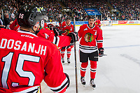 KELOWNA, CANADA - APRIL 14: Caleb Jones #3 and Colton Veloso #39 of the Portland Winterhawks fist pump the bench to celebrate a goal against the Kelowna Rockets on April 14, 2017 at Prospera Place in Kelowna, British Columbia, Canada.  (Photo by Marissa Baecker/Shoot the Breeze)  *** Local Caption ***