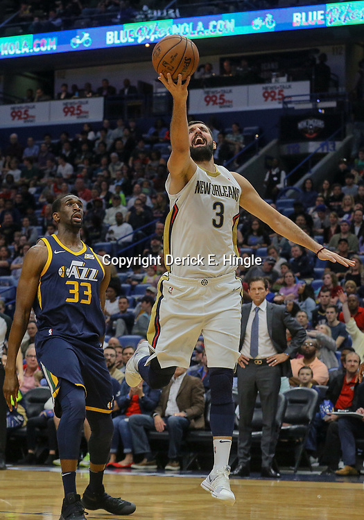 Mar 11, 2018; New Orleans, LA, USA; New Orleans Pelicans forward Nikola Mirotic (3) shoots past Utah Jazz center Ekpe Udoh (33) during the first half at the Smoothie King Center. Mandatory Credit: Derick E. Hingle-USA TODAY Sports