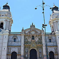 Twin Bell Towers of Lima Cathedral in Lima, Peru <br /> The cornerstone of the Basilica Cathedral of Lima was laid in 1535 and construction, additions and reconstructions continued through 1940. Those magnificent neo-classical twin bell towers took over forty years to build. They were finished in 1649 based on the design of the Cathedral&rsquo;s second architect, Francisco Becerra.  Flanking the Door of Forgiveness is the Door of the Gospel (left) and the Epistle (right).