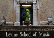 Four year old Amelie walks to formal cello practice at Levine School of Music in Northwest Washington, DC..