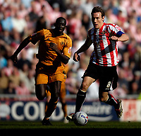 Photo: Jed Wee/Sportsbeat Images.<br /> Sunderland v Wolverhampton Wanderers. Coca Cola Championship. 07/04/2007.<br /> <br /> Sunderland's Dean Whitehead (R) with Wolves' Seyi Olofinjana.
