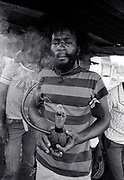 Burning Spear at home smoking Ganga with pipe ( Chalice ) - St Ann's Bay Jamaica 1978