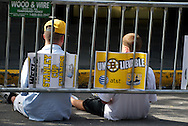 June 18, 2011, Boston, MA - Two Bruins fans sit down against the guard rail waiting for the parade to begin. Fans began lining up on the parade route more than four hours before the scheduled start time. Photo by Lathan Goumas.
