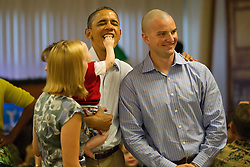 Eight month old Cooper Wall Wagner as Cooper sticks his fingers in US President Barack Obama's mouth as the President poses for a picture with Cooper's parents Greg and Meredith Wagner in Kaneohe, Hawaii, USA on Sunday, December 25, 2011.   The President and Mrs. Obama make their annual trip to greet current and retired members of the US military and their families as they eat a Christmas Day meal Anderson Hall mess hall at Marine Corps Base Hawaii. Photo by Kent Nishimura/ABACAPRESS.COM  | 302579_007 Kaneohe Etats-Unis United States