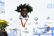 Eliud Kipchoge (KEN) poses with medal after winning the 45th Berlin Marathon in a world best 2:01.39 in Berlin, Germany, Sunday, Sept. 16, 2018.. Kipchoge  broke the previous record by 1:18 set in 2014  by Dennis Kimetto. It is the largest single improvement on the marathon world record since Derek Clayton improved the mark by 2:23 in 1967. (Jiro Mochizuki/Image of Sport)
