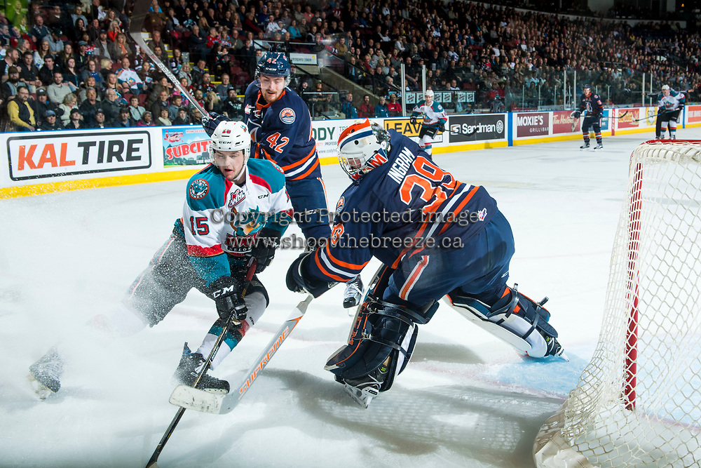 KELOWNA, CANADA - MARCH 31: Tomas Soustal #15 of the Kelowna Rockets digs for the puck while checked by Ondrej Vala #42 as Connor Ingram #39 of the Kamloops Blazers clears the zone on March 31, 2017 at Prospera Place in Kelowna, British Columbia, Canada.  (Photo by Marissa Baecker/Shoot the Breeze)  *** Local Caption ***