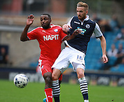 Chesterfield player Sylvan Ebanks-Blake and Millwall player Mark Beevers battle for the loose ball during the Sky Bet League 1 match between Millwall and Chesterfield at The Den, London, England on 29 August 2015. Photo by Bennett Dean.