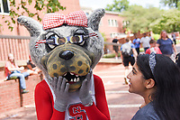 Mrs. Wuf tries on her solar glasses on August 21, 2017, for Solar Eclipse Day on the Brickyard.