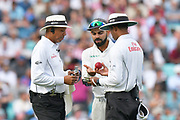 Virat Kohli (captain) of India talking to the umpires as he is not happy with the replacement ball during day 3 of the 5th test match of the International Test Match 2018 match between England and India at the Oval, London, United Kingdom on 9 September 2018.